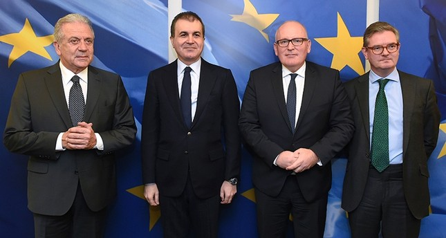 EU Commissioner of Migration Avramopoulos,Turkey's EU Minister Çelik, EU Commission First Vice-President Timmermans and EU Commissioner for Security Union King at the EU headquarters in Brussels on November 30, 2016. (AFP Photo)