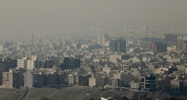 A general view taken from Western Tehran shows a blanket of brown-white smog covering the city as heavy pollution hit the Iranian capital on November 13, 2019. (AFP Photo)