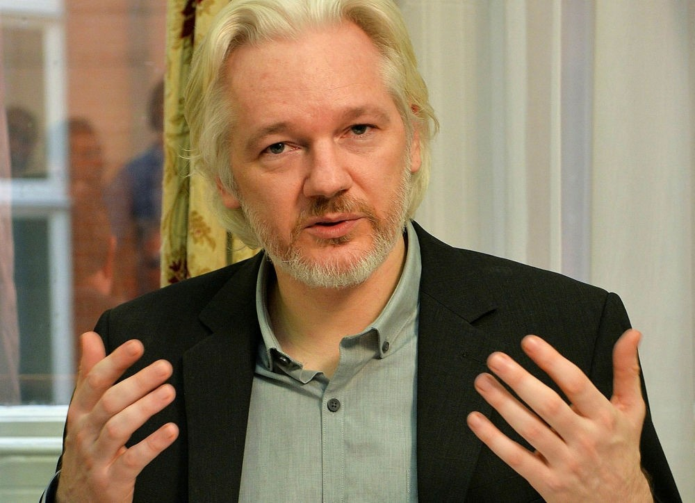 WikiLeaks founder Julian Assange gesturing during a press conference inside the Ecuadorian Embassy in London.