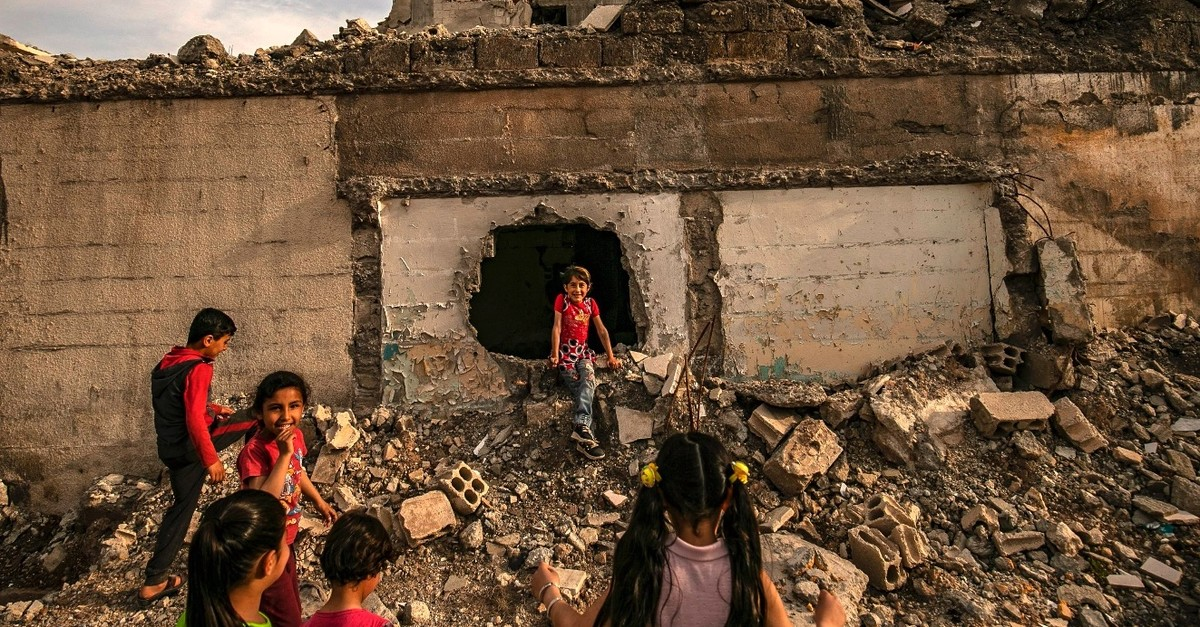 Children play amidst debris in the northern Syrian city of Raqqa, the former Syrian capital of the notorious Daesh, May 1, 2019.