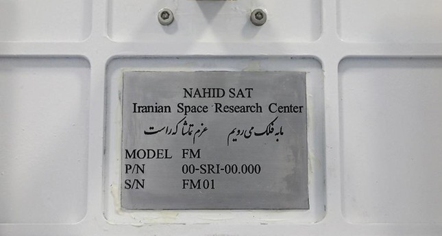 A handout photo made available by Iran's Information and Communication Ministry office on August 31, 2019 shows a view of the plaque on the Nahid-1 domestically-built satellite at the space research centre in Tehran. AFP Photo