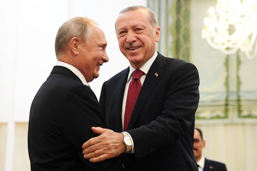 President Recep Tayyip Erdou011fan (R) shakes hands with Russian President Vladimir Putin during their meeting in Tehran, Sept. 7.