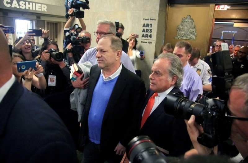 Harvey Weinstein, center, leaves with his lawyer Benjamin Brafman, right, after posting bail at Manhattan's Criminal Court, Friday, May 25, 2018, in New York. (AP Photo)