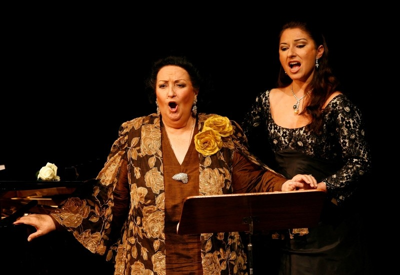 In this Nov. 17, 2006, file photo, Spanish soprano Montserrat Caballe, left, performs with her daughter Montserrat Marti, right, on the occasion of the celebration of her 50th stage anniversary in Basel, Switzerland. (AP Photo)