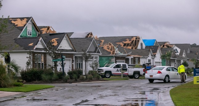 A tornado touched down in the The Farm at Brunswick County in Carolina Shores, N.C. on Thursday, Sept. 5, 2019, damaging homes ahead of Hurricane Dorian's arrival. The Sun News via AP