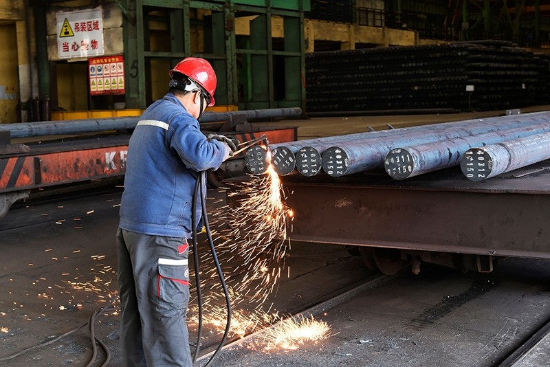 A worker cuts steel at a factory in Zouping in China's eastern Shandong province on April 9, 2018. (AFP Photo)
