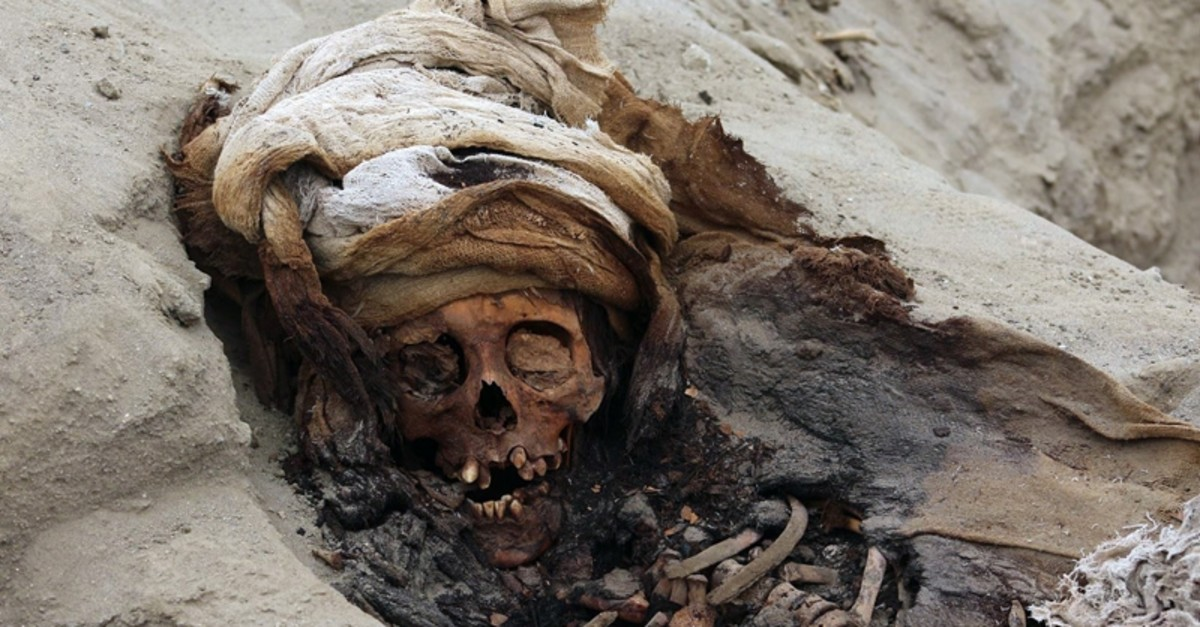 This undated picture, released by Andina Agency, shows the remains of one of 227 children allegedly offered as sacrifice by the pre-Columbian culture Chimu, uncovered by archaeologists in the Pampa La Cruz sector in Huanchaco, Peru. (AFP Photo)