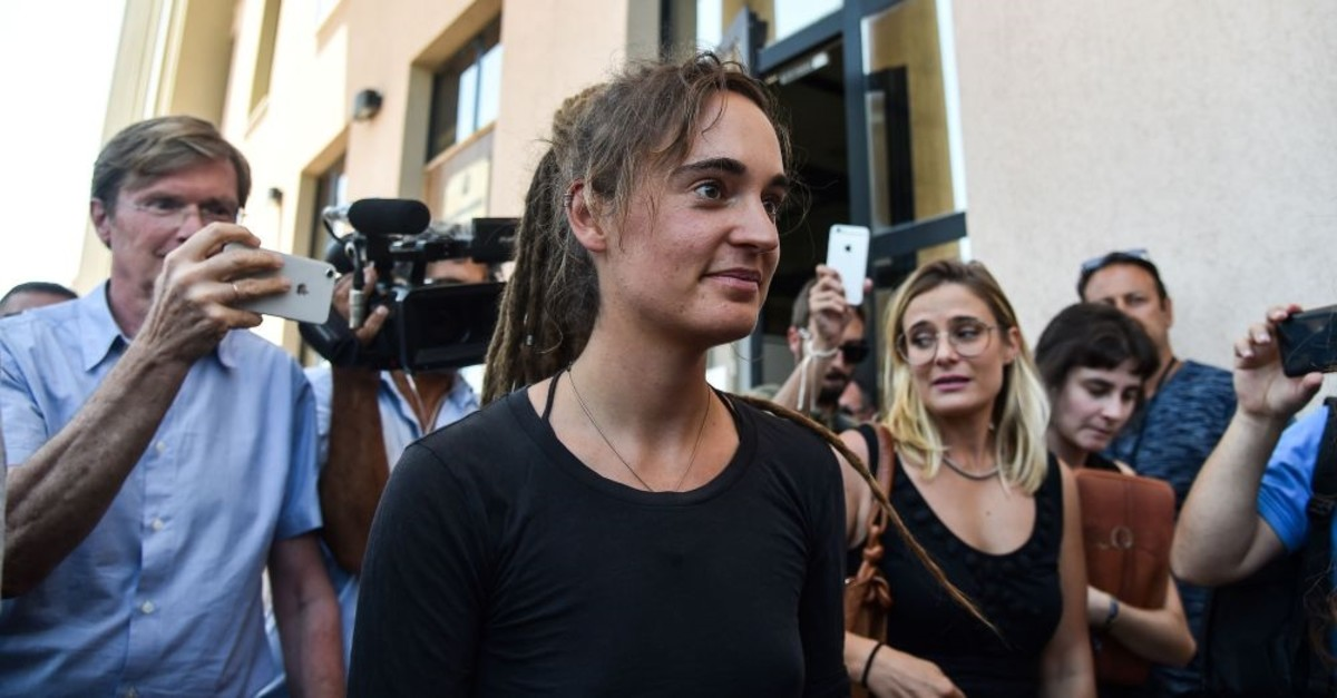 German captain of the Sea-Watch 3 Carola Rackete (C), who sparked international headlines by forcibly docking at an Italian port with rescued migrants, leaves the courthouse of the southern Sicilian town of Agrigento