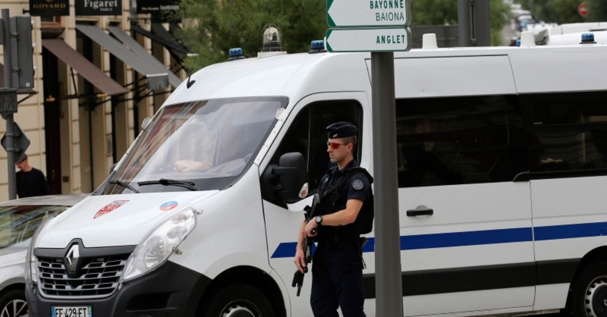 A riot police officer controls a checkpoint ahead of the upcoming G7 summit, Tuesday, Aug.20, 2019 in Biarritz, southwestern France (AP Photo)
