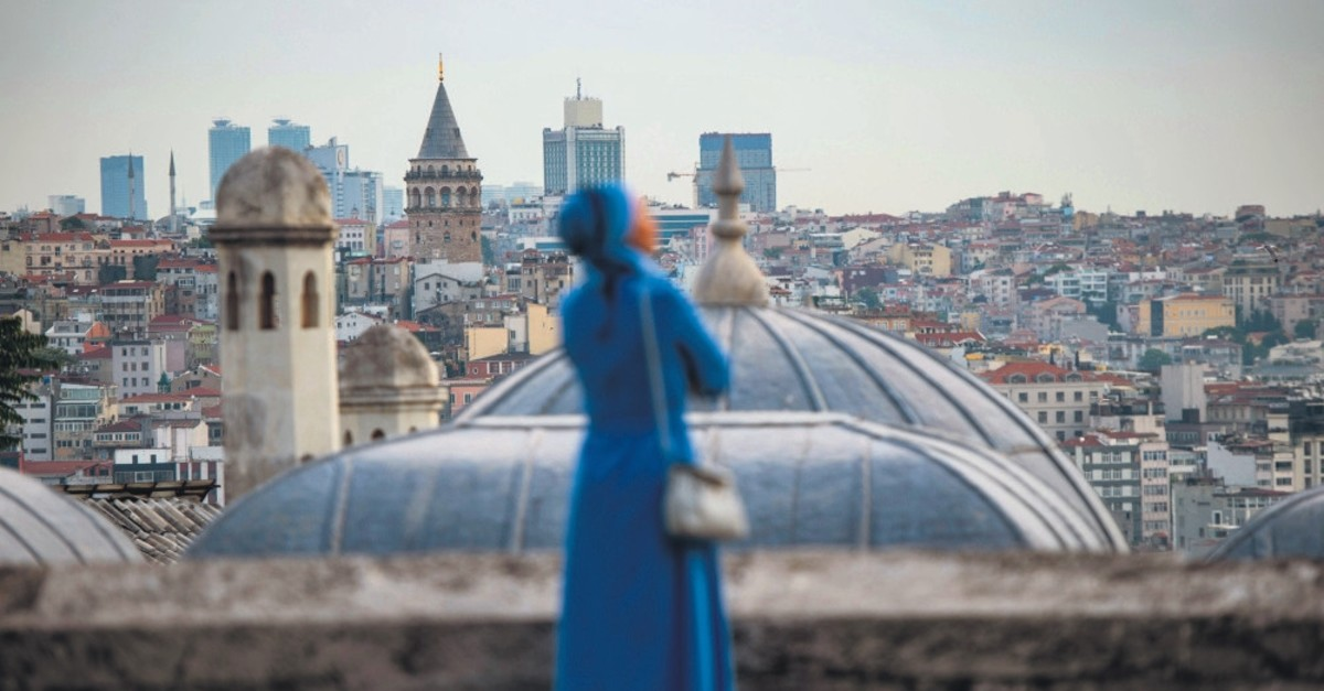 A woman looks on from the terrace of the Su00fcleymaniye Mosque after Ramadan Bayram (Eid al-Fitr) prayers, Istanbul, June 4, 2019.