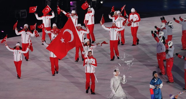 Turkish National ski jumper Fatih Arda İpcioğlu carries the national flag during the parade at the opening ceremony of the   Pyeongchang 2018 Winter Olympics on Feb.9.