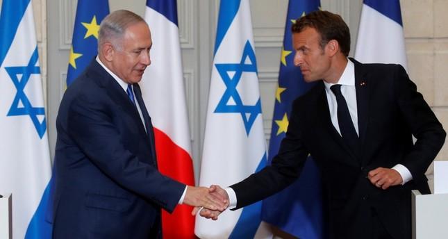 الرئيس الفرنسي مستقبلاً نظيره الإسرائيلي اليوم (الفرنسية)