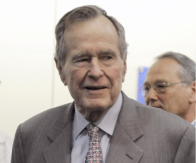 In a Tuesday, Dec. 2, 2008 file photo, former President George H. W. Bush leaves a news conference at the Houston hospital. (AP Photo)