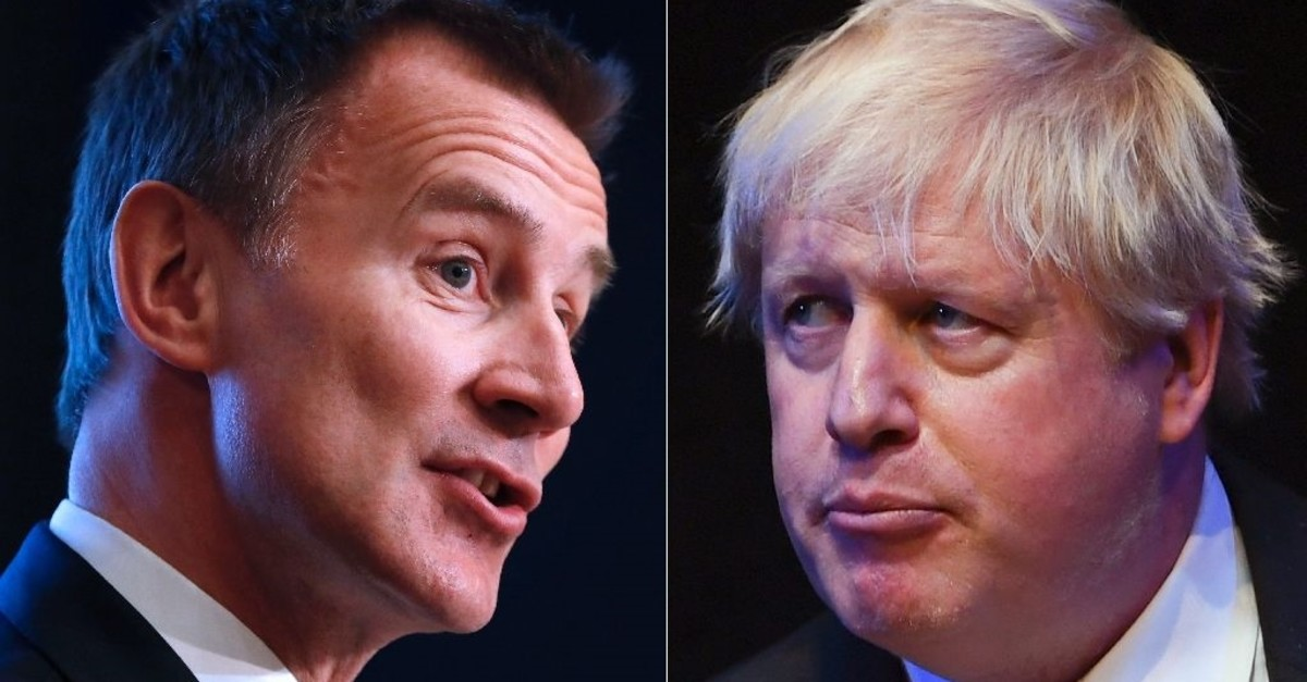 Britain's Foreign Secretary Jeremy Hunt (L) has called on his rival Boris Johnson (R) to ,man up, over a domestic row scandal. (AFP Photo)