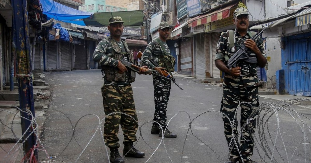 Security personnel stand guard at a roadblock ahead of Friday noon prayers, Jammu, August 9, 2019.
