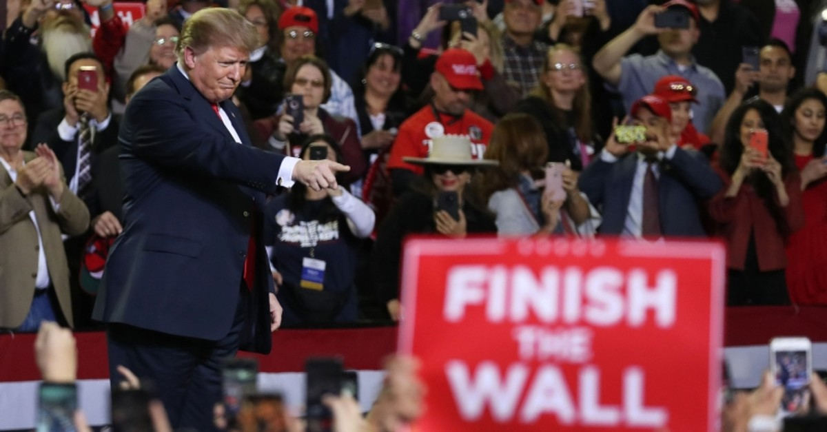 Trump continues his campaign for a wall to be built along the border as the Democrats in Congress are asking for other border security measures. (AFP Photo)