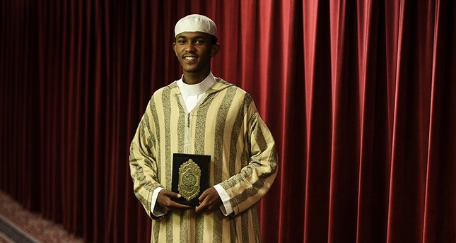 In this June 19, 2018 photo, Ahmed Burhan Mohamed poses for a photo at his mosque, the Abubakar Assidiq Islamic Center in Minneapolis. (AP Photo)