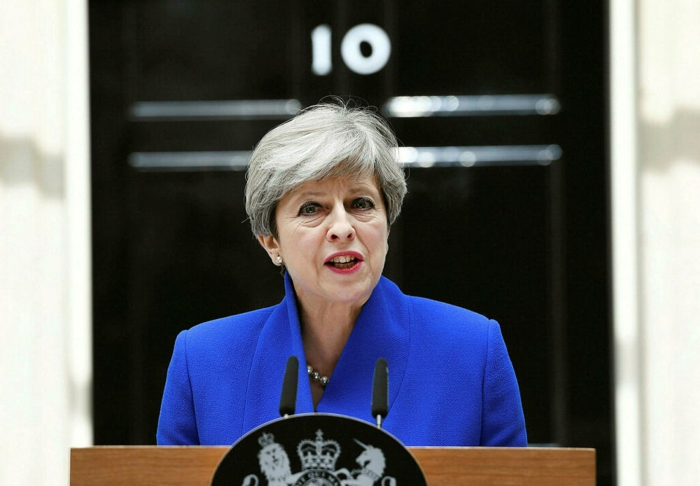 Britain's Prime Minister Theresa May gives a statement to the media outside No. 10 Downing Street in London, June 9.