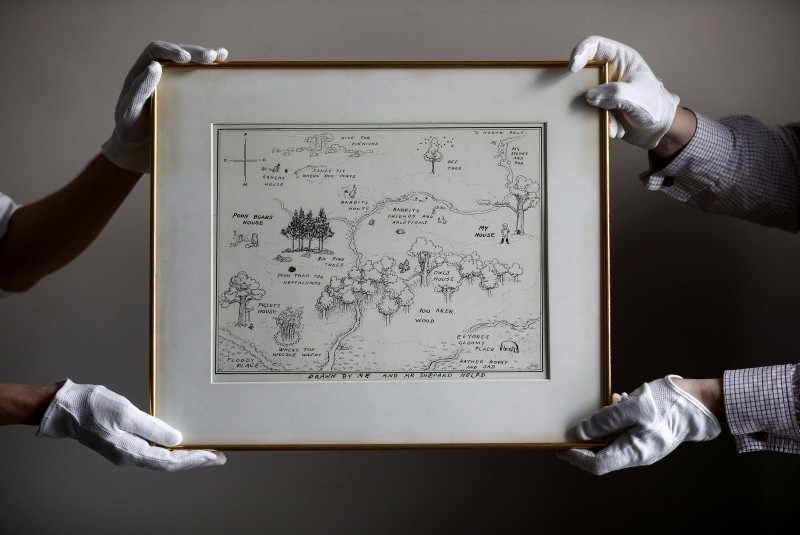 Sotheby's staff hold the original map of Winnie the Pooh's Hundred Acre Wood by E.H. Shepard at Sotheby's auction rooms in London, Britain, May 31, 2018. (REUTERS Photo)