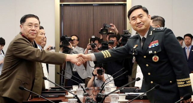North Korean Lieutenant General An Ik San shakes hands with South Korean Major General Kim Do-gyun during a meeting at the Peace House of the border village of Panmunjom, South Korea, July 31, 2018. (Yonhap via Reuters)