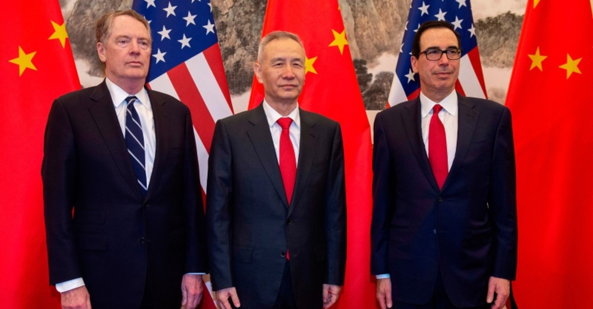In this file photo taken on March 28, 2019 China's Vice Premier Liu He (C) poses for a photo with US Treasury Secretary Steven Mnuchin (R) and US Trade Representative Robert Lighthizer (L) at Diaoyutai State Guesthouse in Beijing. (AFP Photo)