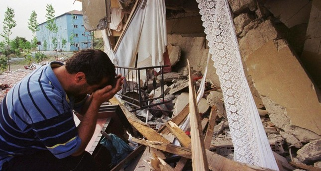 An earthquake survivor weeps next to his destroyed house in the western town of Seymen, İzmit in 1999.
