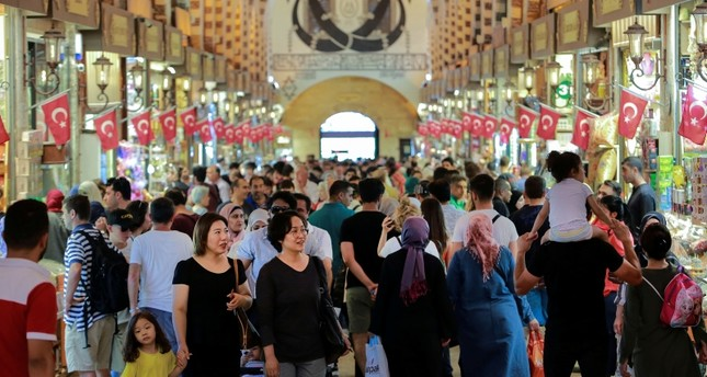 People walk in a market in Istanbul, Monday, Aug. 13, 2018. AP Photo