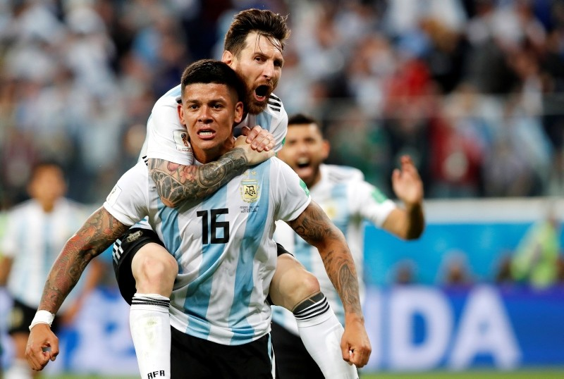 Marcos Rojo of Argentina celebrates with teammate Lionel Messi (top) after scoring the 2-1 during the FIFA World Cup 2018 group D preliminary round. (EPA Photo)