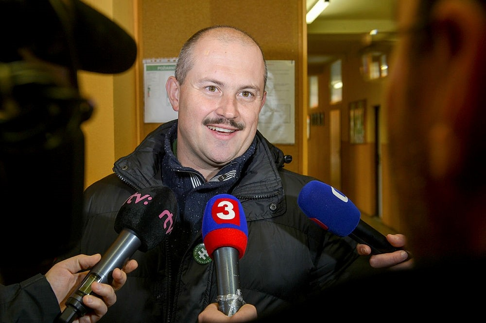 Banska Bystrica governor and far-right political leader Marian Kotleba speaks to journalists after casting his vote during the Slovak regional elections in Banska Bystrica, Central Slovakia, Saturday Nov. 4, 2017. (CTK via AP)