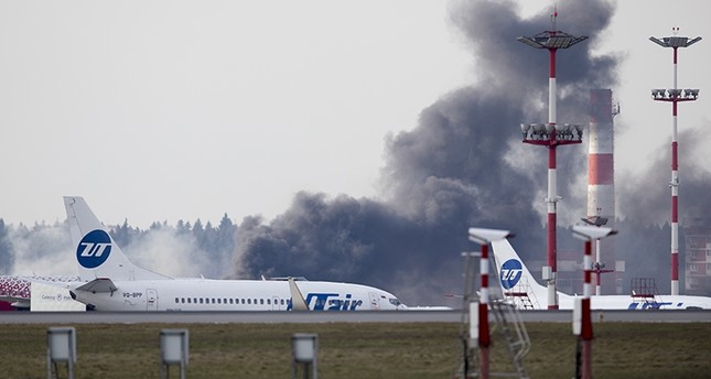 Smoke rises behind a runway just before US Secretary of State Rex Tillerson arrival in Moscow's Vnukovo airport, Russia (AP Photo)