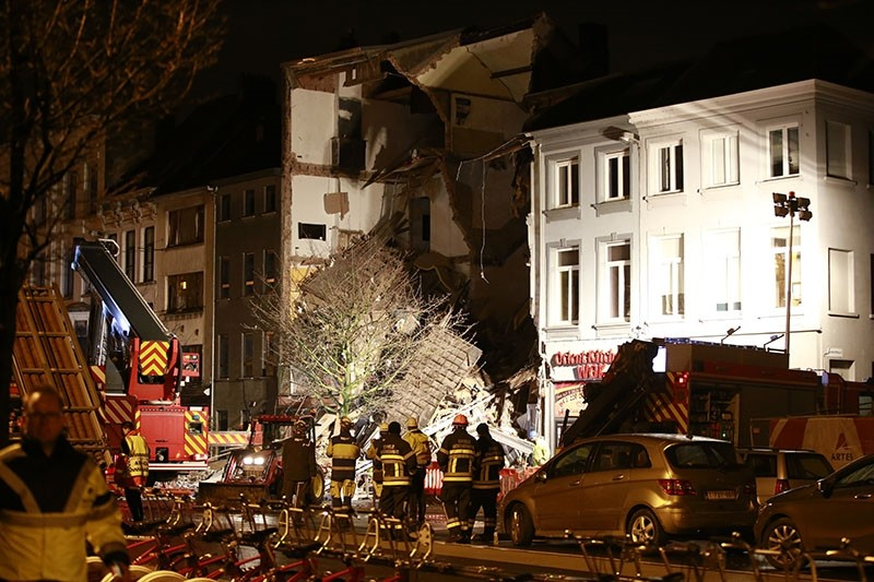 Firefighters inspect the debris, at the Paardenmarkt in Antwerp, Belgium after several buildings collapsed following an explosion, Jan. 15, 2018. (EPA Photo)