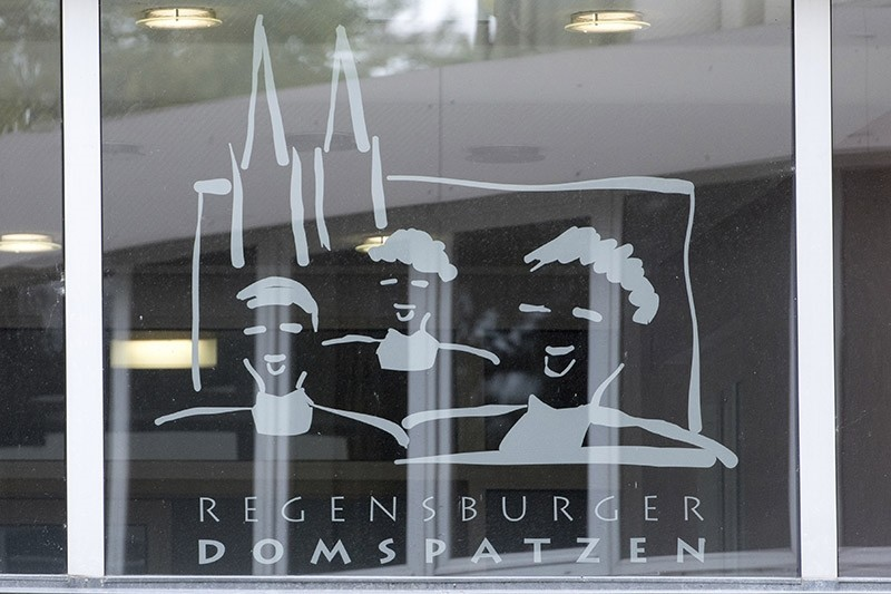 This Oct. 12, 2016 file photo shows the logo of the Regensburger  Domspatzen choir at a window of the high school in Regensburg. (AP Photo)