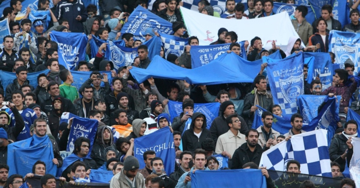 In this Dec. 9, 2011 file photo, supporters of Iranian soccer team Esteghlal, hold flags of their favorite team, at the Azadi (Freedom) stadium, in Tehran, Iran. (AP Photo)