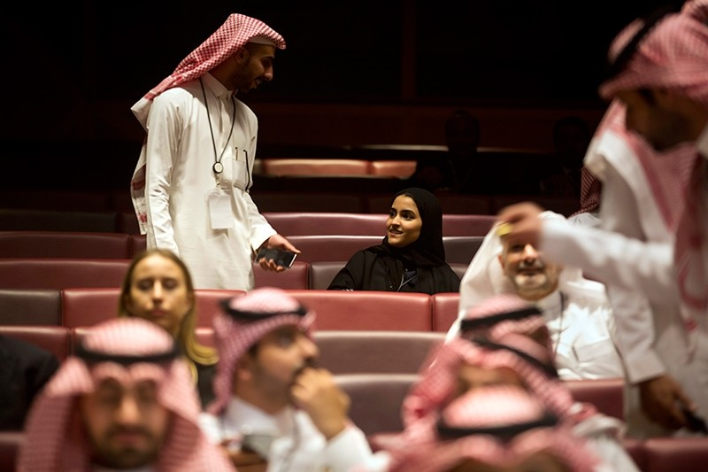 Vsitors wait for the movie to begin during an invitation-only screening, at the King Abdullah Financial District Theater, in Riyadh, Saudi Arabia, Wednesday, April 18, 2018. (AP Photo)