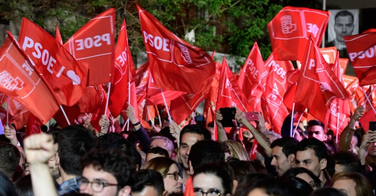 Supporters of ruling Spanish Socialist Party (PSOE) wave flags as they celebrate in front of the party headquarters in Madrid after Spain held general elections on April 28, 2019. (AFP Photo)