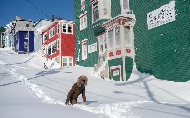 A residents makes their way through the snow in St. John's, Newfoundland on Saturday, Jan. 18, 2020. Andrew Vaughan/The Canadian Press via AP