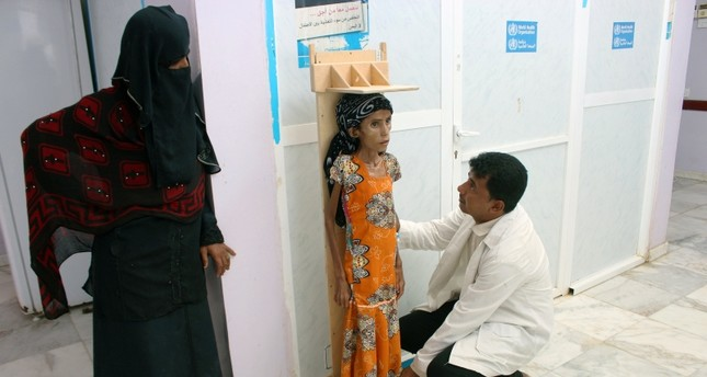 A nurse measures the height of malnourished Fatima Ibrahim Hadi, 12, at a clinic in Aslam of the northwestern province of Hajjah, Yemen Feb. 12, 2019 Reuters File Photo