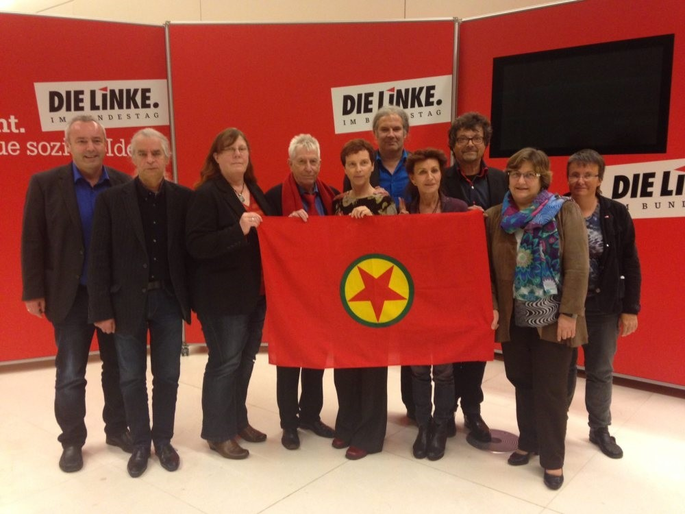 Several German parliamentarians pose with the PKK flag in the German Bundestag, in a photo from November, 2014.