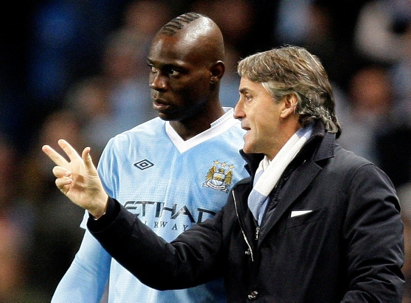 In this Wednesday Dec. 21, 2011 file photo Manchester City's manager Roberto Mancini, right, issues instructions to Italian stiker Mario Balotelli. (AP Photo)