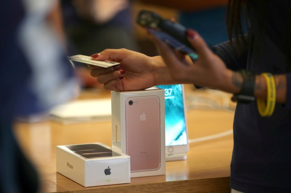 A customer buys the new iPhone 7 smartphone inside an Apple Inc. store in Los Angeles.
