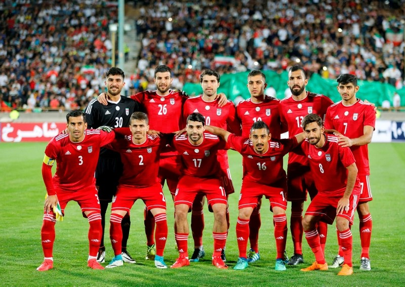 In this file photo taken on May 19, 2018 Iran's starting eleven line-up for a group picture ahead of their international friendly match against Uzbekistan at Tehran's Azadi Stadium on May 19, 2018 (AFP Photo)