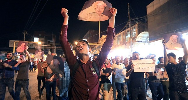 Demonstrators gather in the streets in support of Kurdish president Masoud Barzani on the night of the stabbing of one Kurdish journalist. (Reuters Photo)