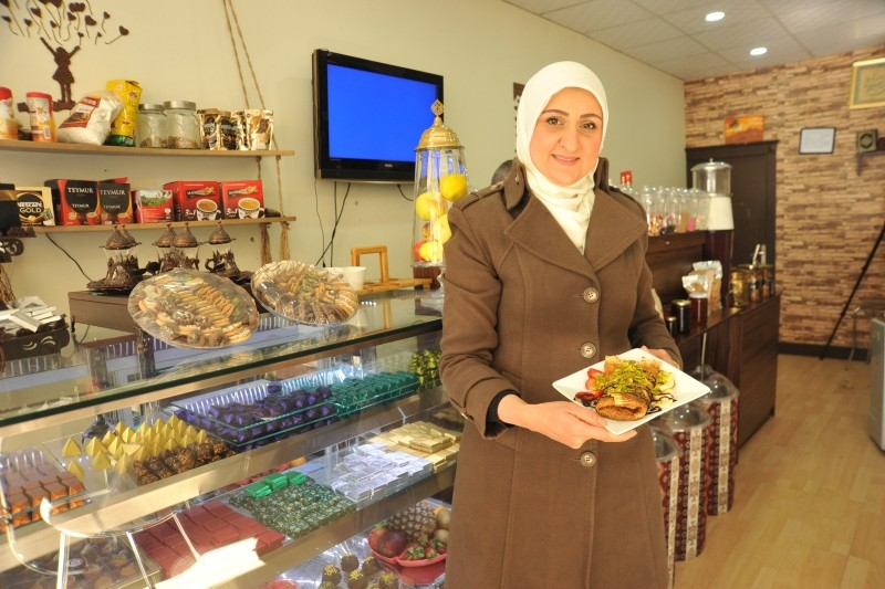 Lubna Hilli poses with her chocolate products in her 'chocolate house' in Gaziantep. (AA Photo)