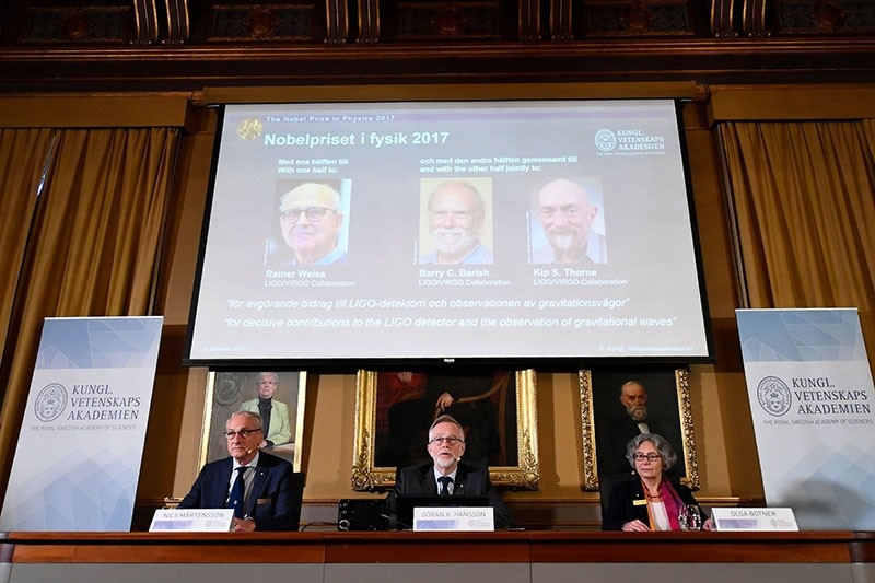 Prof. Nils Martensson, chairman, Goran K Hansson, SG of the Royal Swedish Academy of Sciences and Olga Botner, Prof. of Experimental Elementary Particle Physics, announce 2017 Nobel Prize winners in Physics on Oct. 3, 2017 in Stockholm. (AFP Photo)