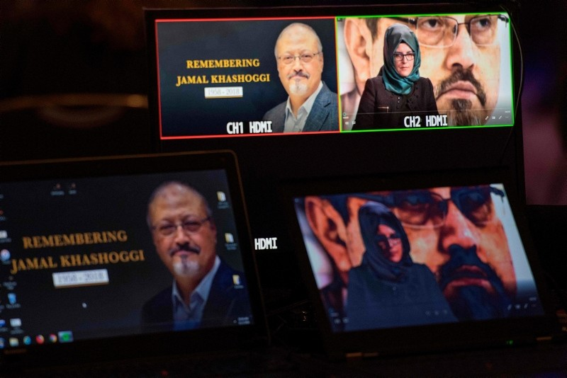 Hatice Cengiz, the fiancee of the late Washington Post journalist Jamal Khashoggi, delivers a prerecorded message (upper R) during a remembrance ceremony for her fiancu00e9e in Washington, DC. (AFP Photo)