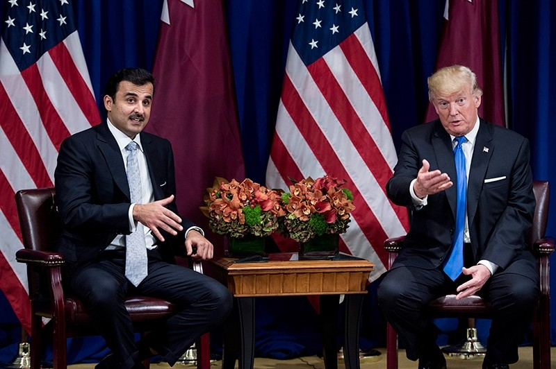Qatar's Emir Tamim bin Hamad al-Thani (L) and U.S. President Donald Trump make comments for the press before a meeting at the Palace Hotel, on the sidelines of the United Nations General Assembly, Sept. 19, 2017, New York, U.S. (AFP Photo)