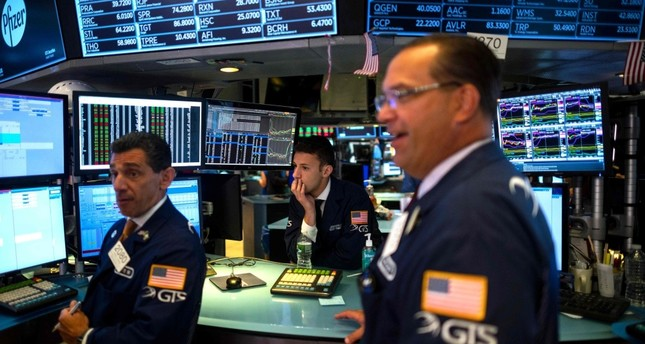Traders work after the opening bell at the New York Stock Exchange (NYSE), New York City, July 16, 2019.