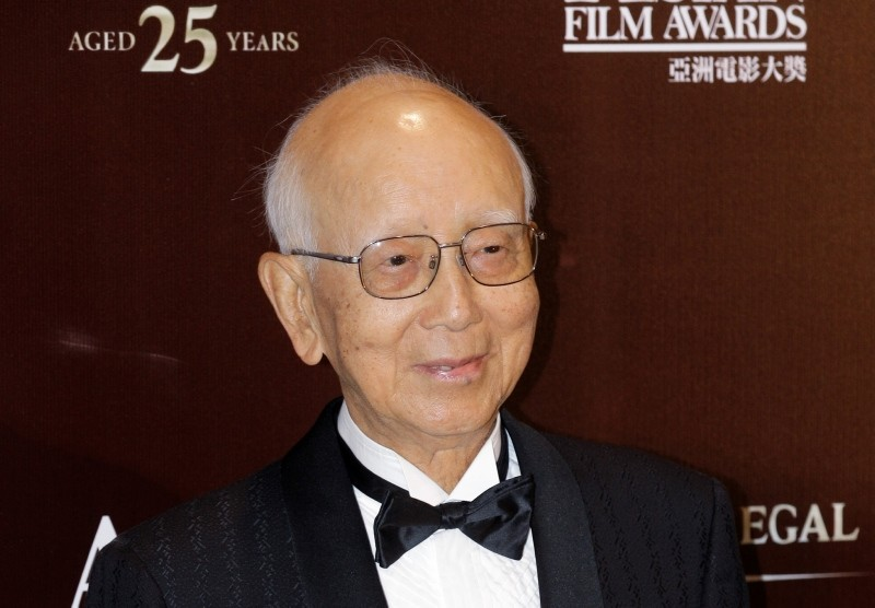 In this March 21, 2011, photo, Hong Kong film producer Raymond Chow receives the Lifetime Achievement award at the Asian Film Awards in Hong Kong. (AP Photo)
