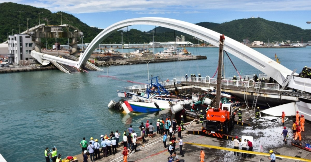 Rescuers work near the site of a collapsed bridge in Nanfangao, eastern Taiwan. Tuesday, Oct. 1, 2019. (AP Photo)