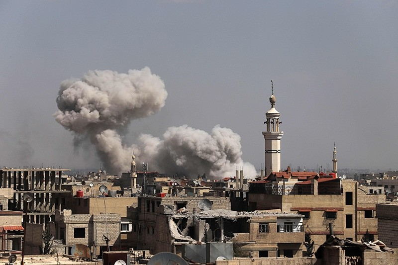 Smoke billows following Syrian government bombardment on the opposition-controlled town of Kafr Batna, in the besieged Eastern Ghouta region on the outskirts of the capital Damascus on March 11, 2018. (AFP Photo)